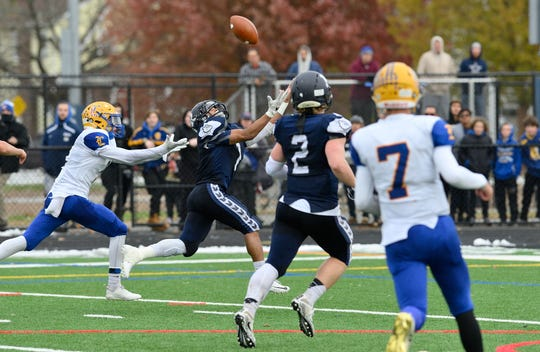 Rutherford's Abellany Mendez reaches for a catch in the North 2, Group 2 football championship game against Lyndhurst in Rutherford.