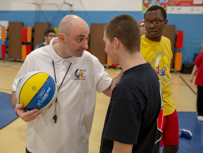Coach Mike Simmel encourages a participant during a Bounce Out the Stigma project basketball camp on November 17, 2018 at the Hawthorne Boys and Girls Club in Hawthorne, NJ.