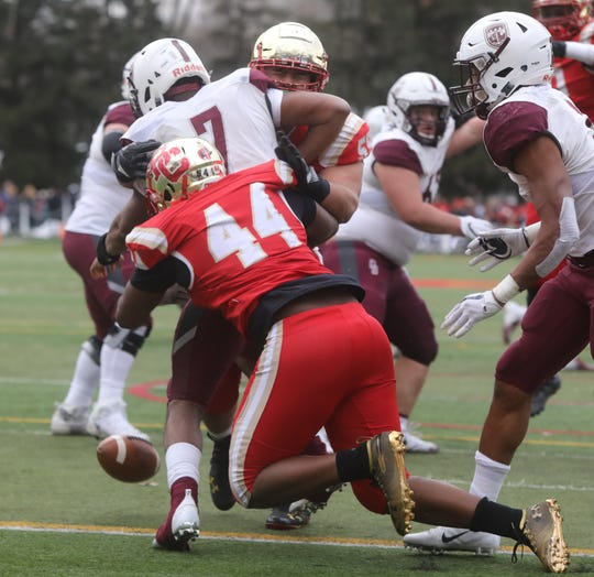 Jahquil Batts of Don Bosco has the ball stripped from him by Jeremiah Grant of Bergen Catholic. Bergen Catholic recovered the fumble for a second half TD.