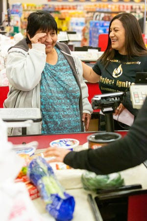 Elizabeth Herrera of Hatch, left, becomes emotional when Margie Gleason, Encompass Home Health branch director, pays for her groceries at Save Mart on Valley Drive on Saturday, Nov. 17, 2018. Encompass Health sponsored the event where multiple unsuspecting customers had their groceries paid for in an effort to give back to the community for the holiday season.