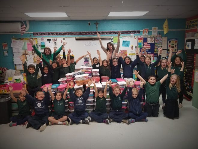 Las Cruces Catholic School students collected 235 boxes of items for needy children around the globe this Christmas as part of Operation Christmas Child.