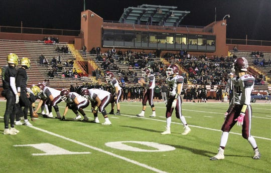 The Tularosa Wildcats prepare to run a play at Friday night's 3A State Championship Quarterfinal against the Hope Christian Huskies. The Huskies won the game 67-14.