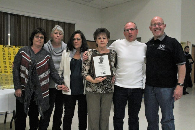 Jimmie Randall's wife, Juanita, center, holds a plaque honoring Jimmie at the Otero County Crime Stoppers fundraiser Oct. 20. Pictured from left to right are Tiffany Carnes, Tonya Sanchez, Cheryl Woods, Juanita, Tom Thompson and Crime Stopper Executive Board Member Steve Muell.