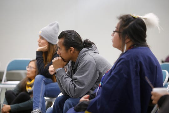 San Juan College faculty members and students listen during a session of the an Indigenous 20 Something Project, an initiative by the Native Wellness Institute, on Friday at the San Juan College Henderson Fine Arts Center in Farmington.