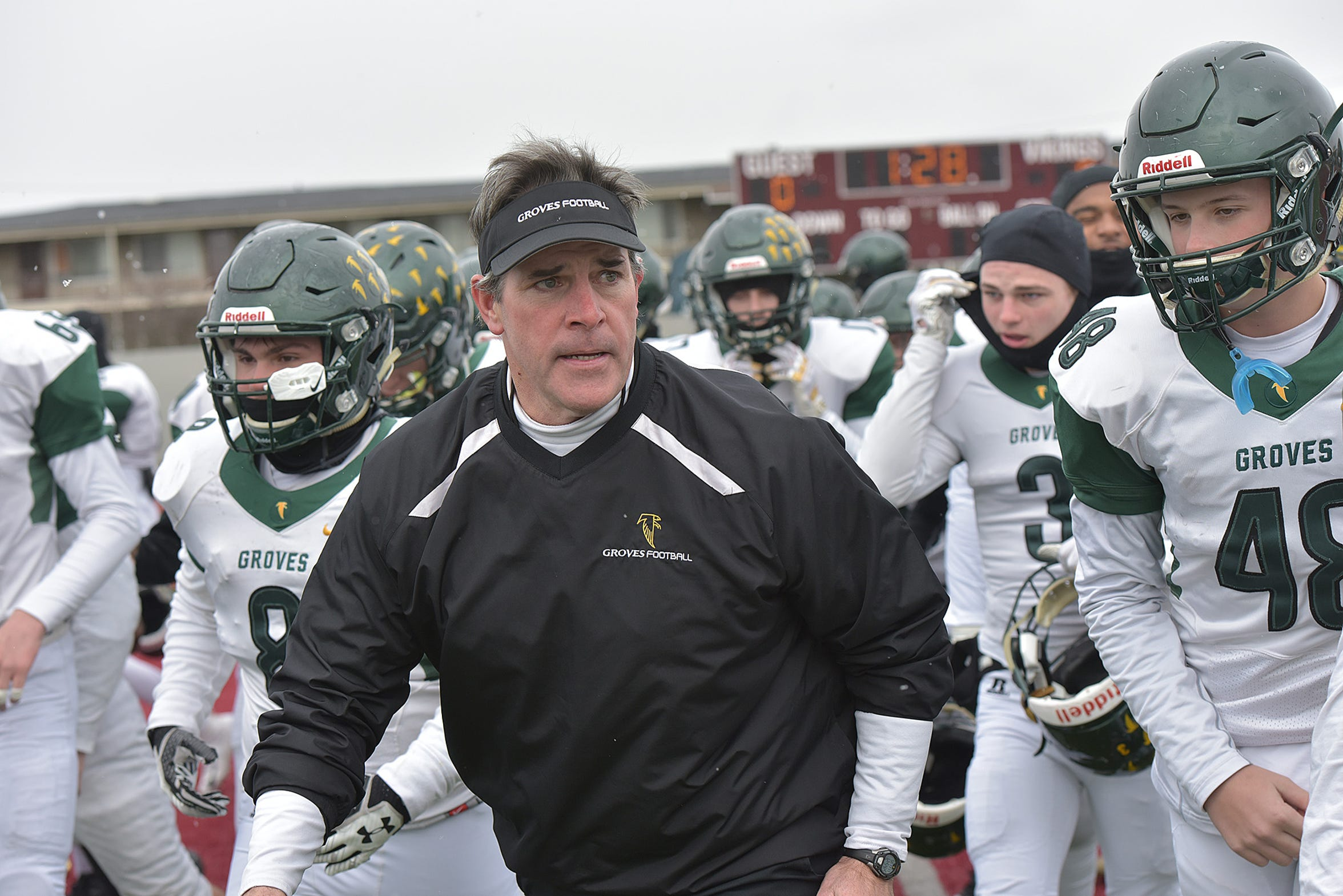 Birminghame Groves Coach Brendan Flaherty and the team take the field.