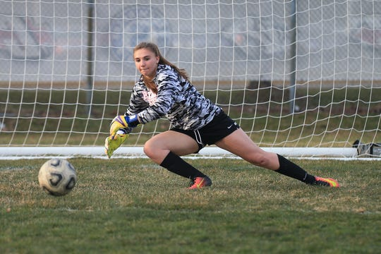 Plymouth goalie Rebecca Przybylo dives for the soccer ball during a spring 2018 contest.