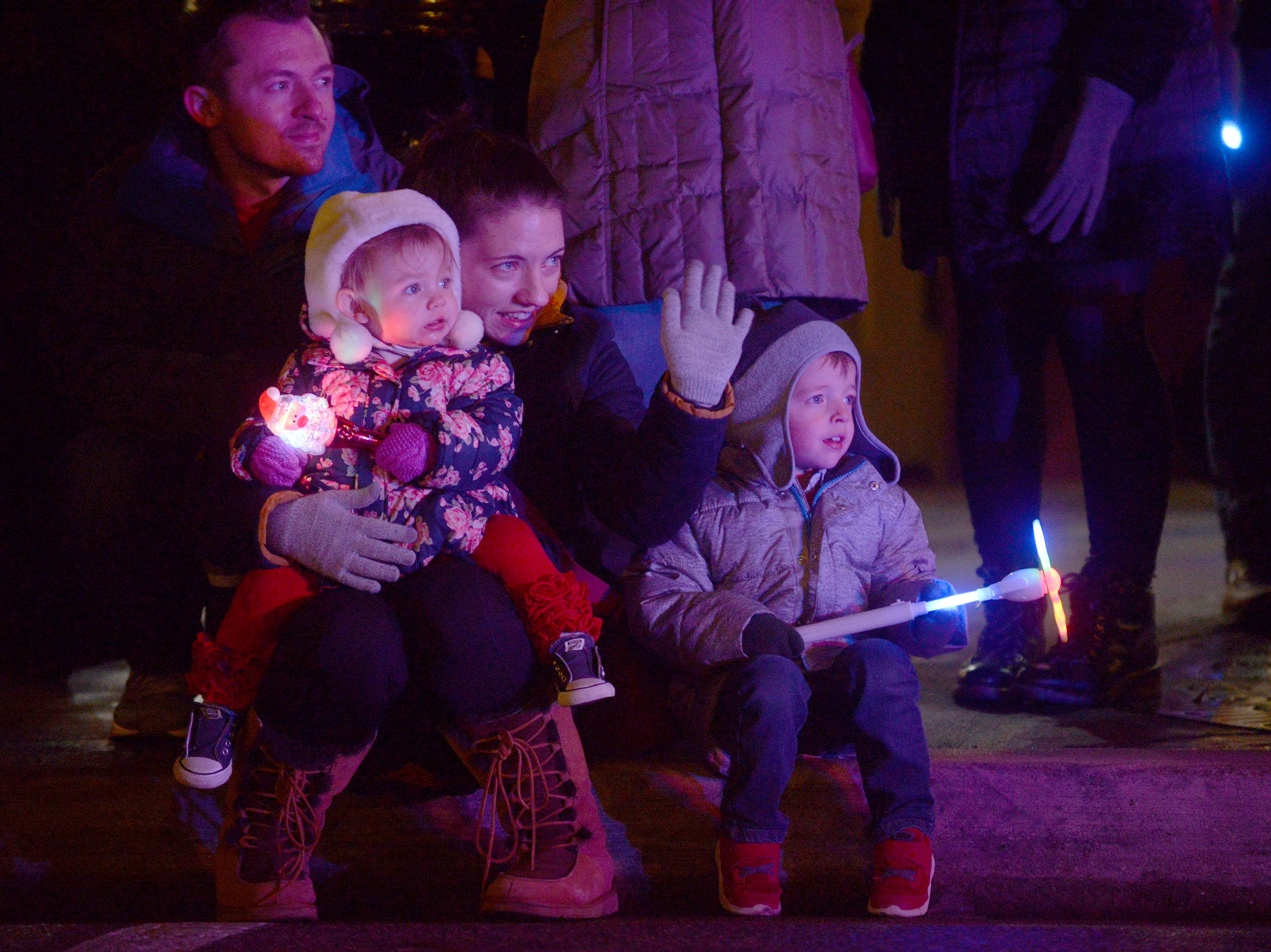 The LaBelle family - Corey (back) Arya, Sara and Asher watch the Holiday Lighted Parade in downtown Northville, Nov. 16, 2018.