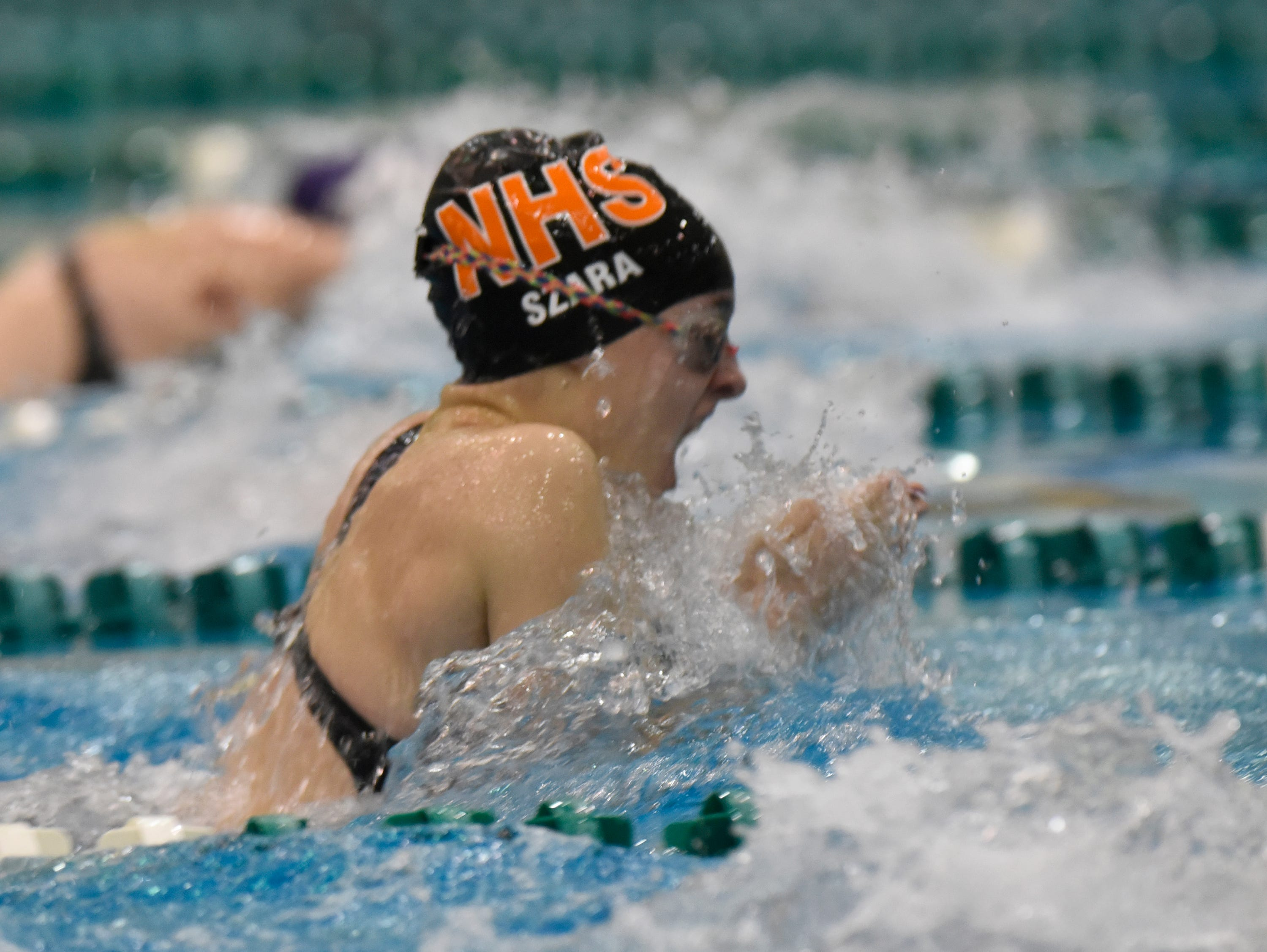 Northville's Riley Szara in the 200 yard medley relay at the Division 1 girls swimming and diving championships held at Eastern Michigan University Nov. 17, 2018.