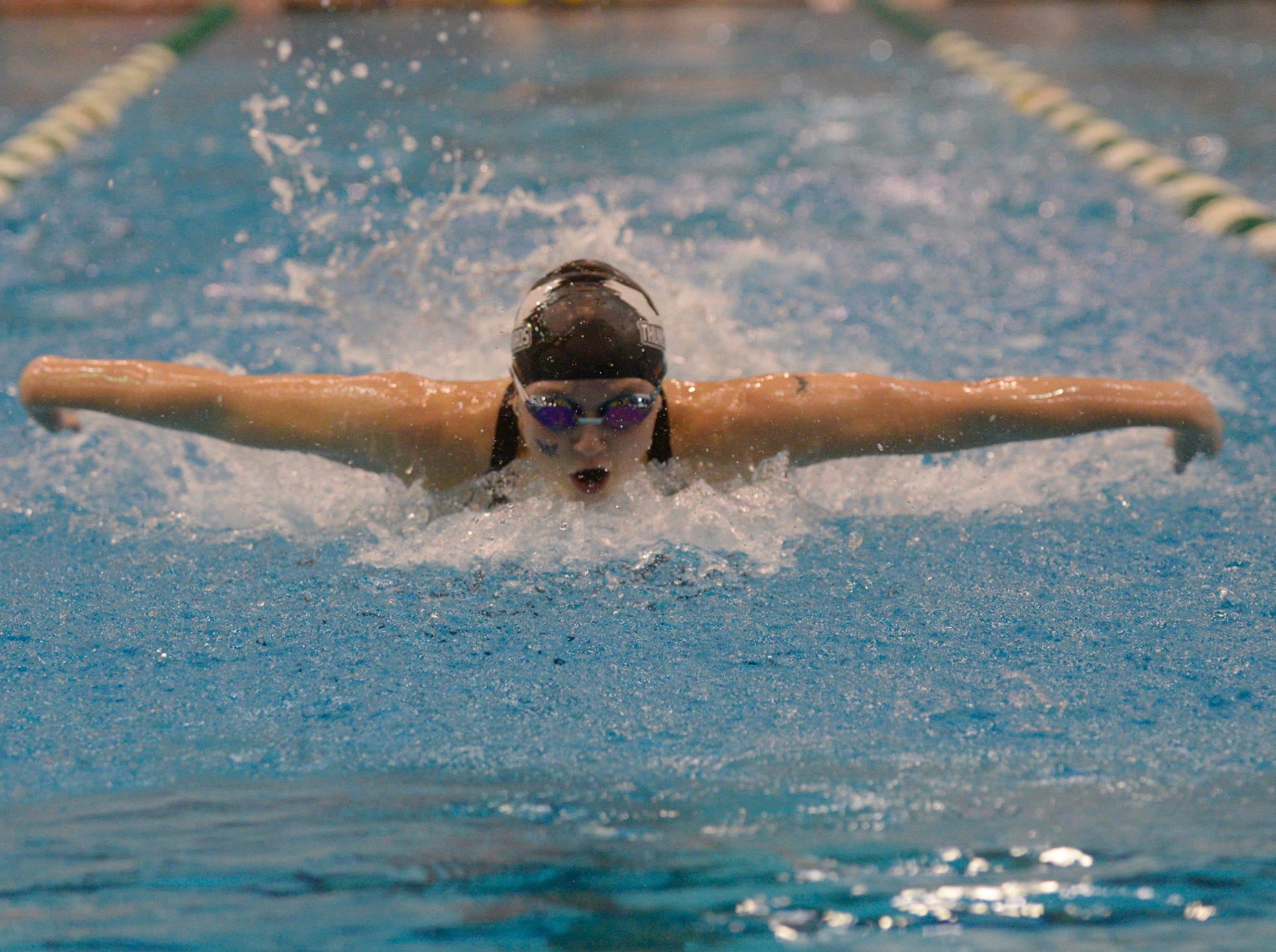 Harrison/Farmington's Madeline Greaves in the 100 yard butterfly at the Division 1 girls swimming and diving championships held at Eastern Michigan University Nov. 17, 2018.