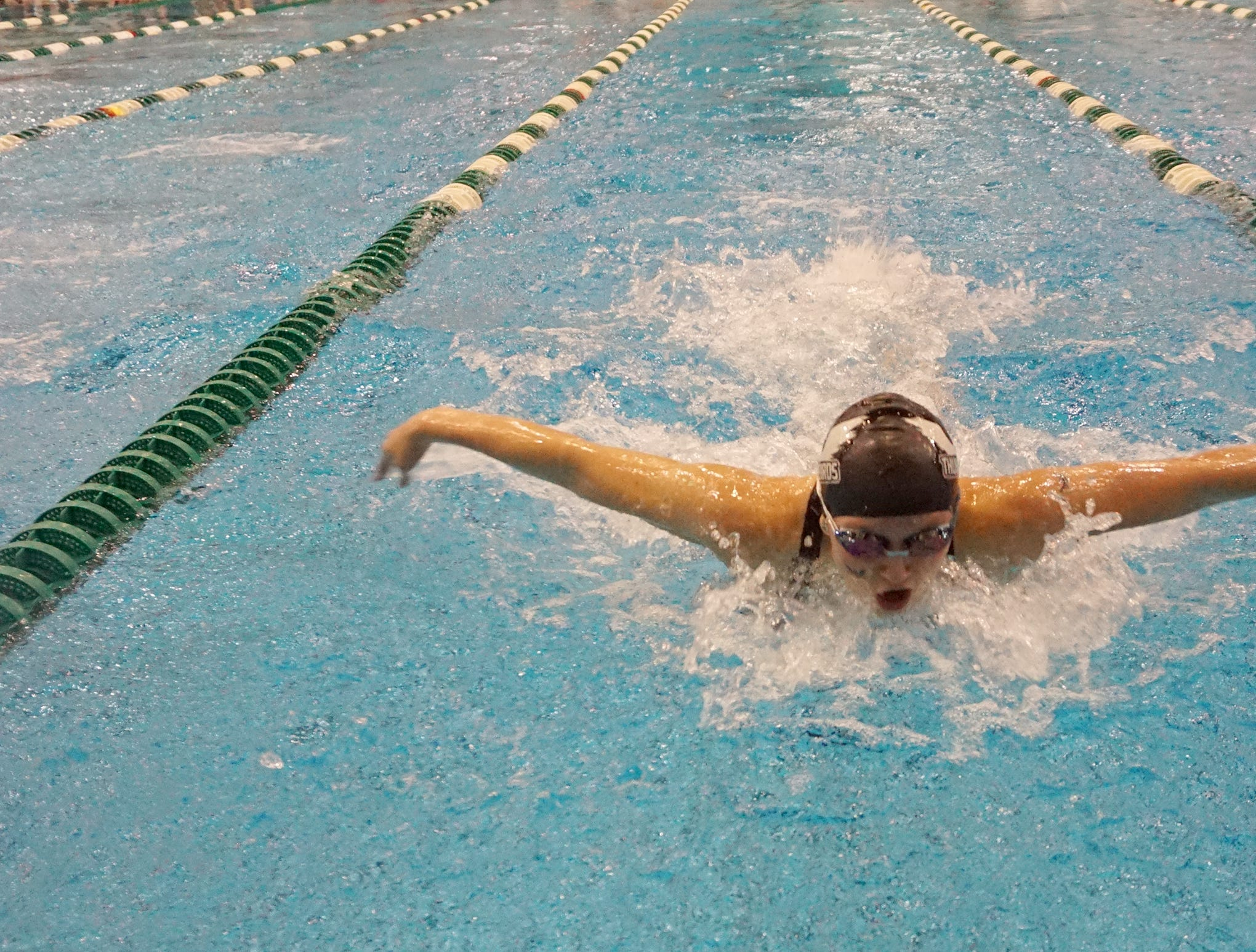 Madeline Greaves from Harrison/Farmington swims to a third-place finish with a time of 55.14 in the 100 butterfly at the Division 1 girls swimming and diving championships held at Eastern Michigan University Nov. 17, 2018.