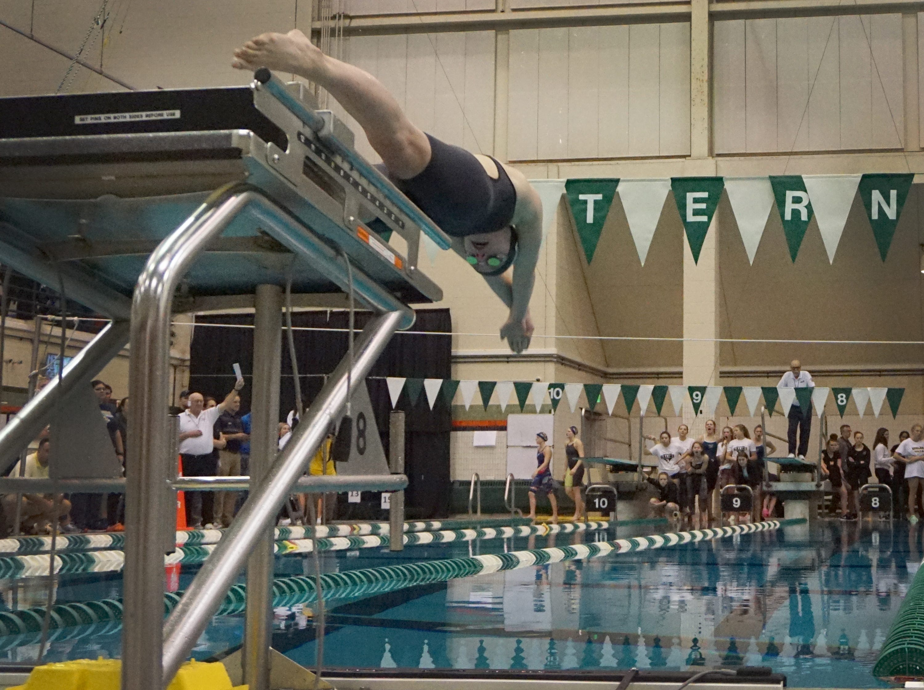 Novi's Julia Katulski leads off the Wildcats 400 yard freestyle relay team at the Division 1 girls swimming and diving championships held at Eastern Michigan University Nov. 17, 2018.