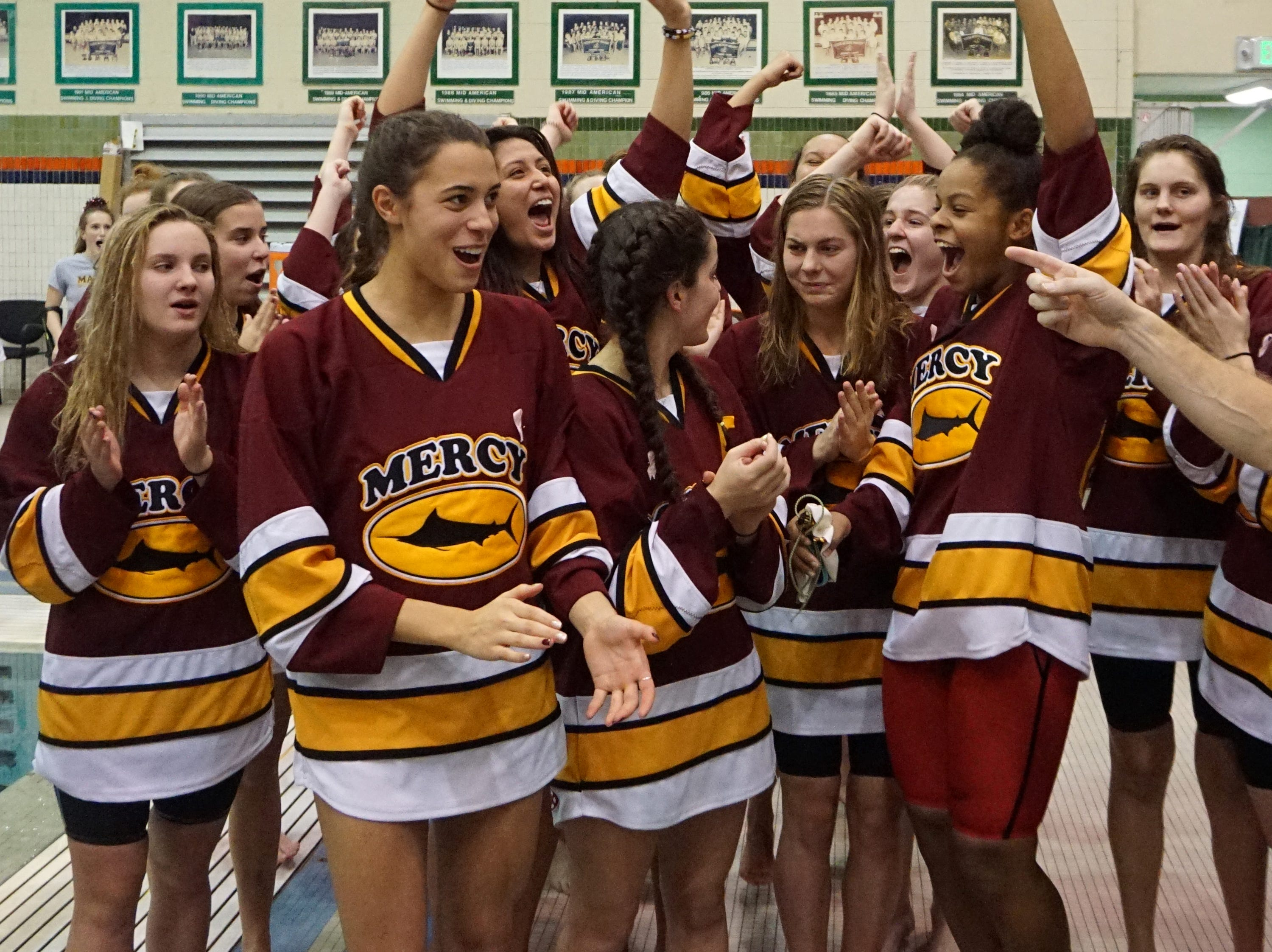 Mercy is announced the top team at the Division 1 girls swimming and diving championships held at Eastern Michigan University Nov. 17, 2018.