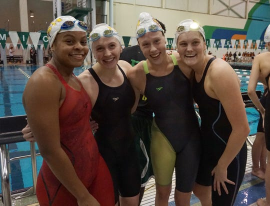 Mercy's 400 yard relay team poses after finishing third behind Saline and Harrison/Farmington at the Division 1 girls swimming and diving championships held at Eastern Michigan University Nov. 17, 2018.