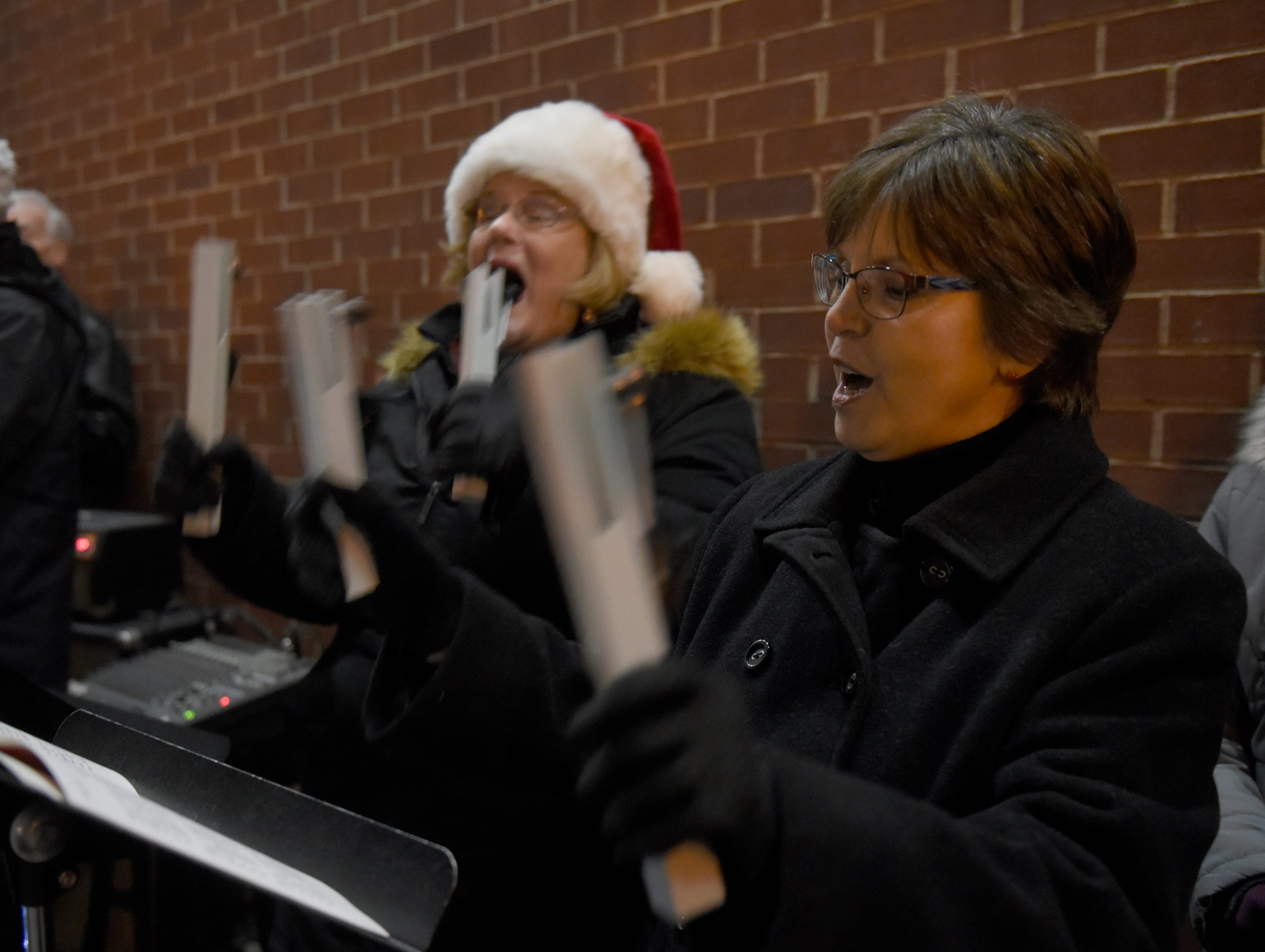 Members of the First Presbyterian Church of Northville sing Christmas Carols before the start of the Holiday Lighted Parade in downtown Northville, Nov. 16, 2018.