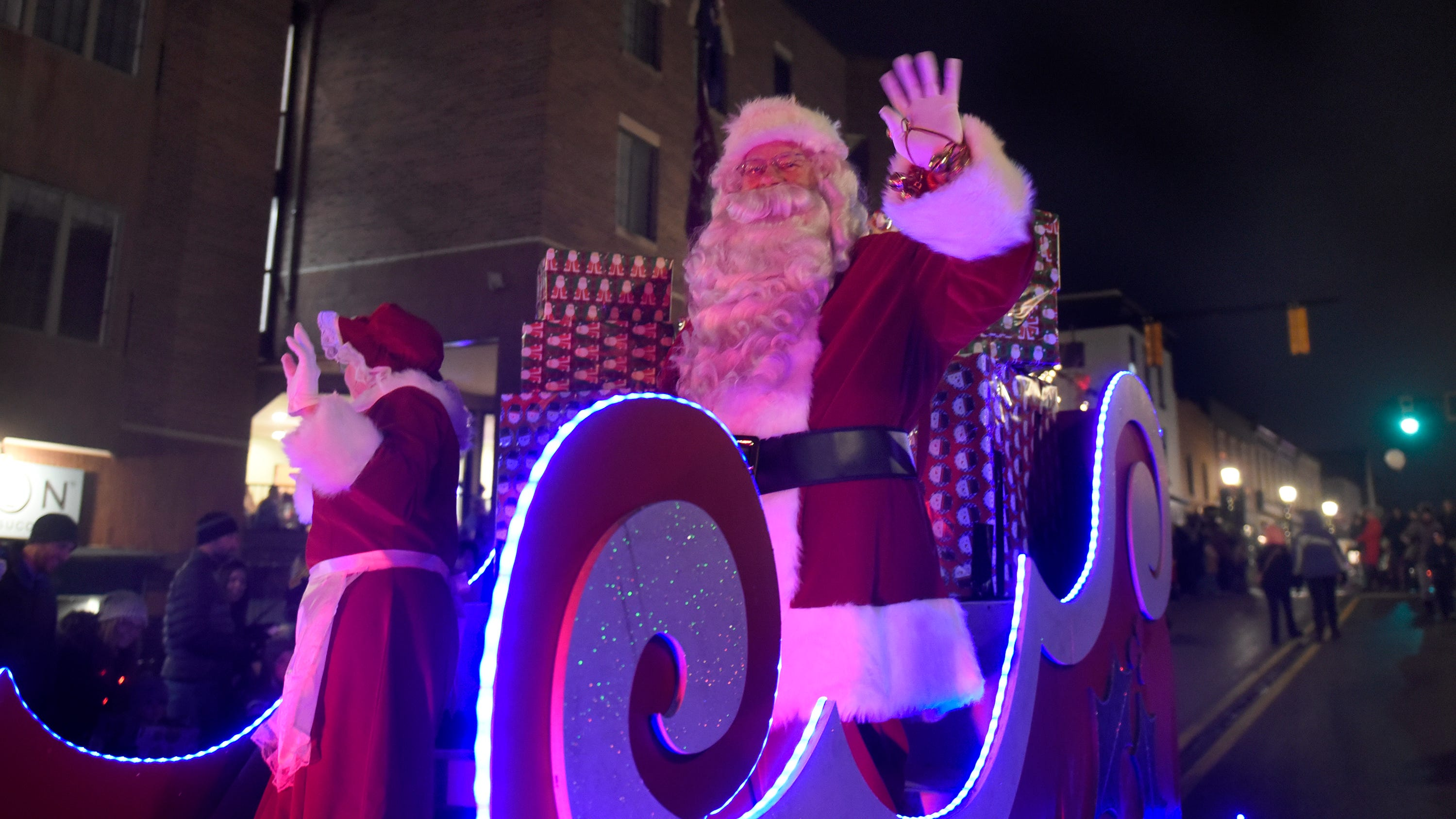 Mr. and Mrs. Claus arrive during the Holiday Lighted Parade in downtown Northville, Nov. 16, 2018.