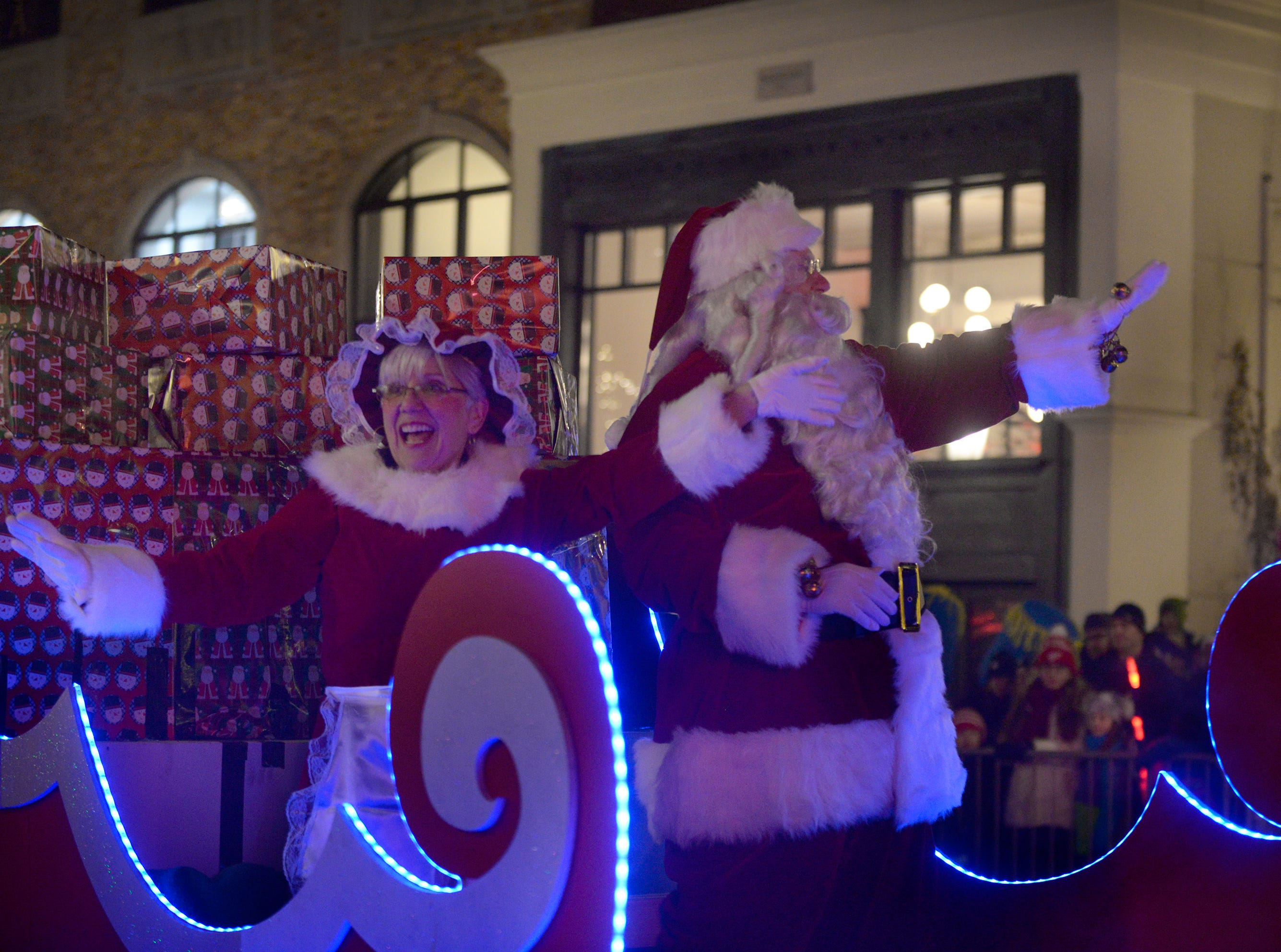 Mrs. Claus and Santa arrive on main Street during the Holiday Lighted Parade in downtown Northville, Nov. 16, 2018.