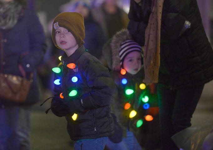 Keiton, 6, and Layne Mills, 4, watch for floats during the Holiday Lighted Parade in downtown Northville, Nov. 16, 2018.