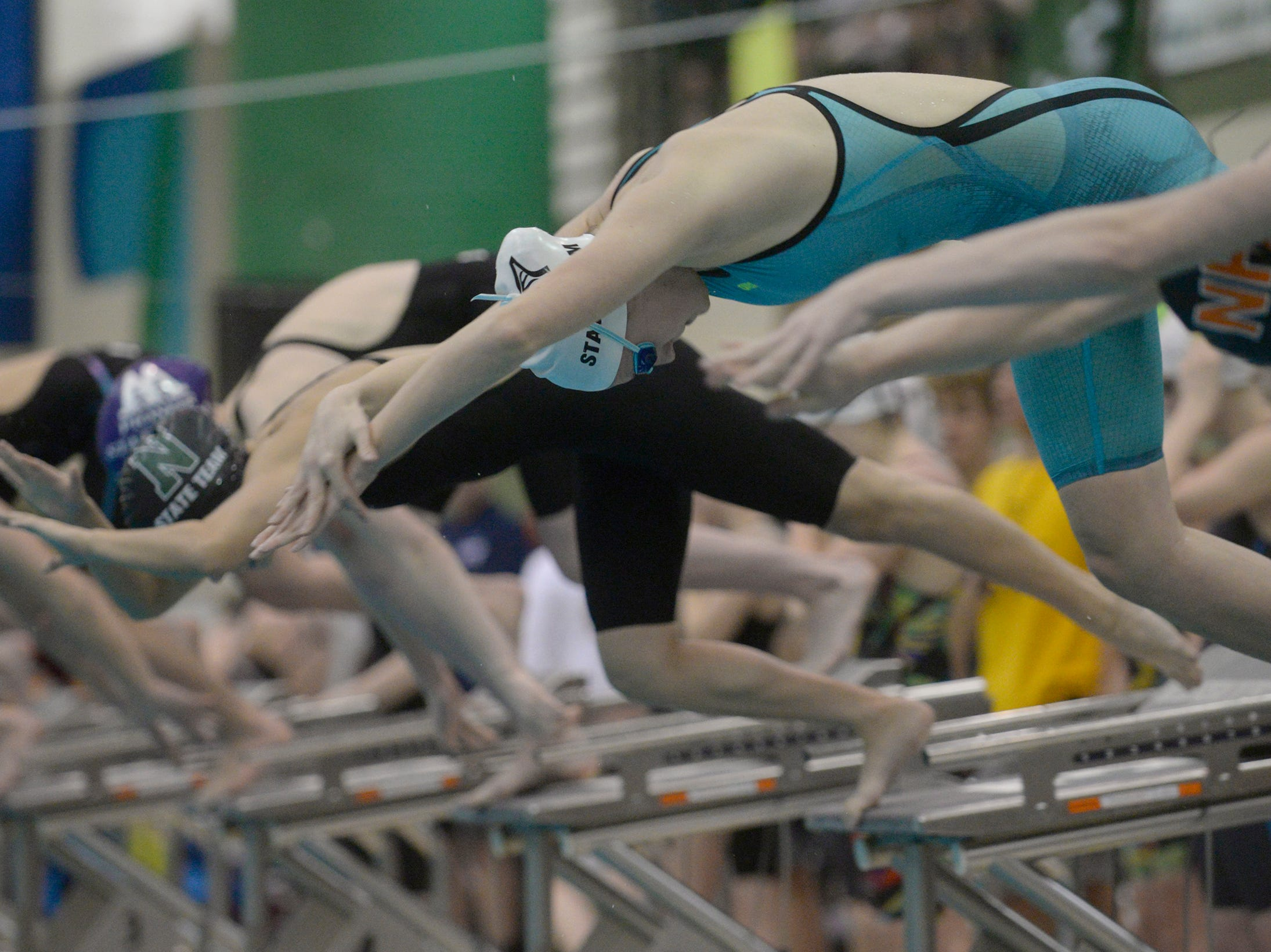 Plymouth's Regan Peregord at the start of the 200 freestyle relay at the Division 1 girls swimming and diving championships held at Eastern Michigan University Nov. 17, 2018.