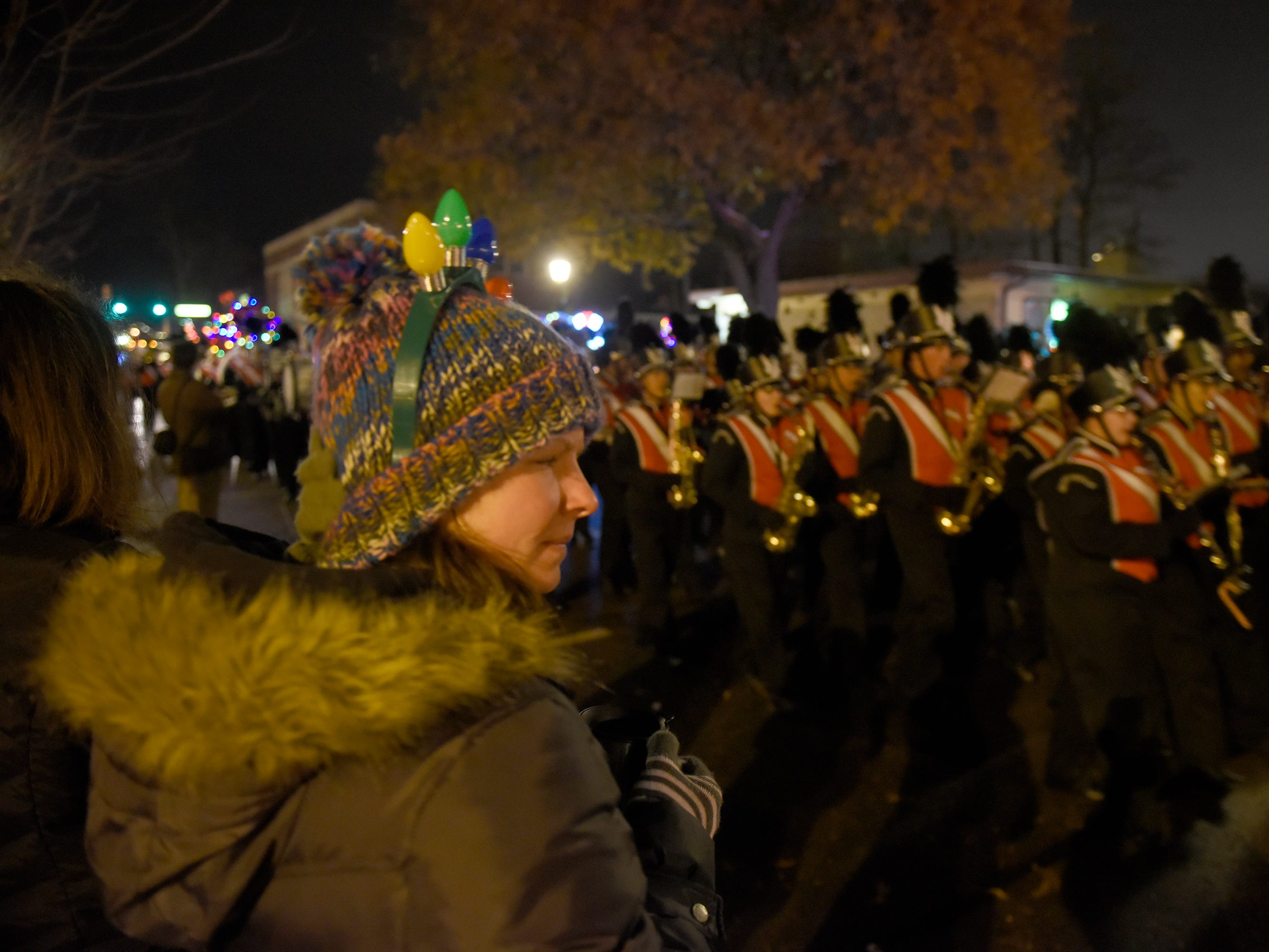 Rebecca Brodie watches the NHS Marching Band during the Holiday Lighted Parade in downtown Northville, Nov. 16, 2018.