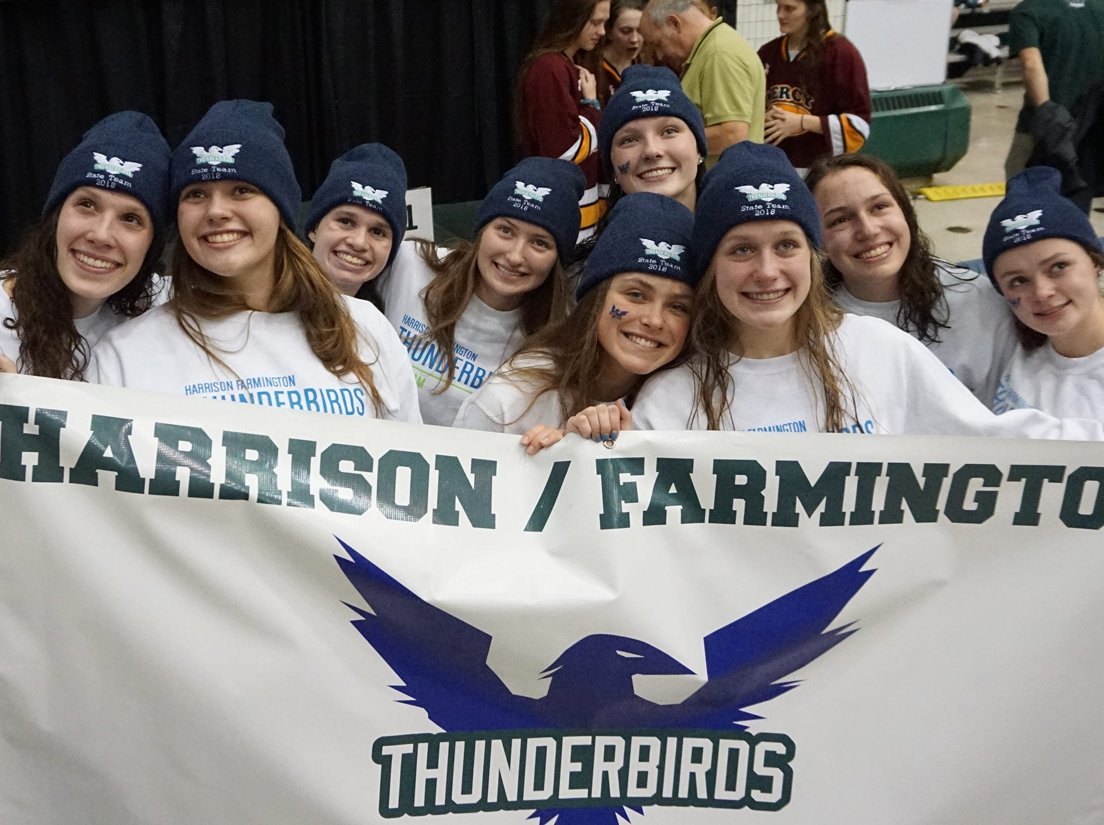 Harrison/Farmington swimmers pose for family and friends after the Division 1 girls swimming and diving championships held at Eastern Michigan University Nov. 17, 2018.
