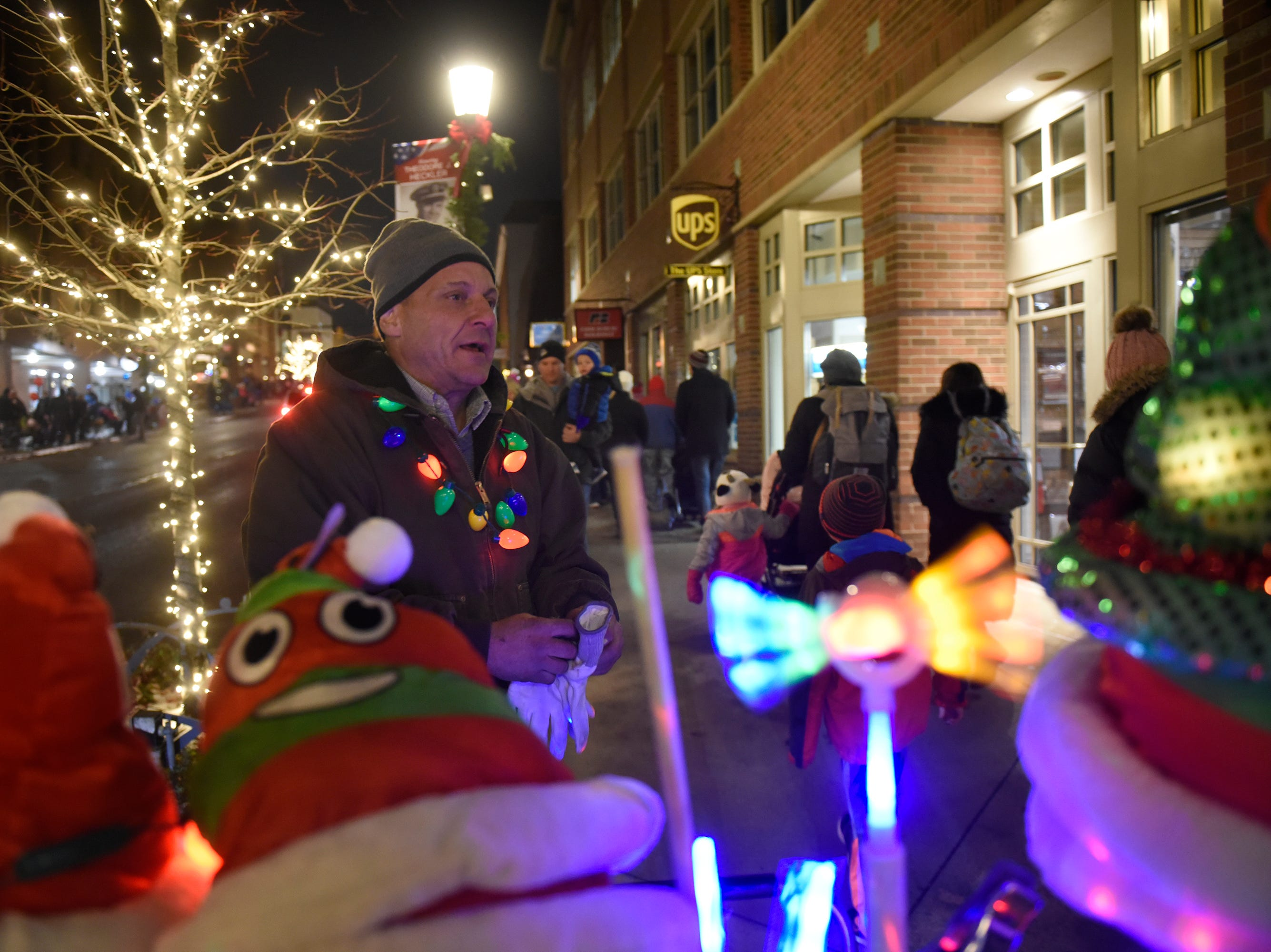 Thomas Gatta hawks lighted toys and wearbles before the start of the Holiday Lighted Parade in downtown Northville, Nov. 16, 2018.