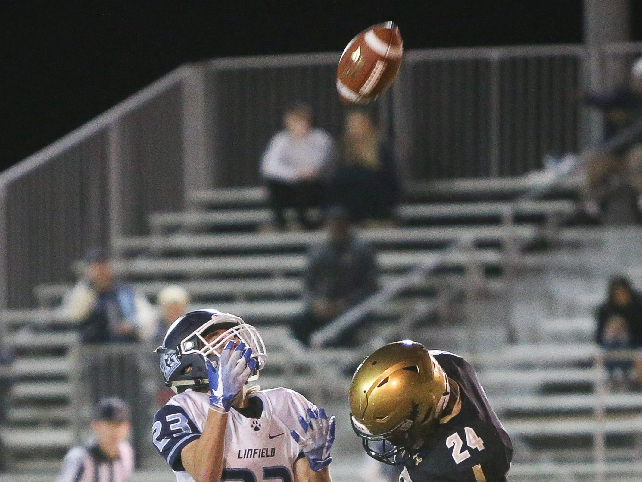 Michael Harkins with the fair catch. The Xavier Prep varsity football team lost Friday's neutral playoff game against Linfield Christian by a score of 57-13.