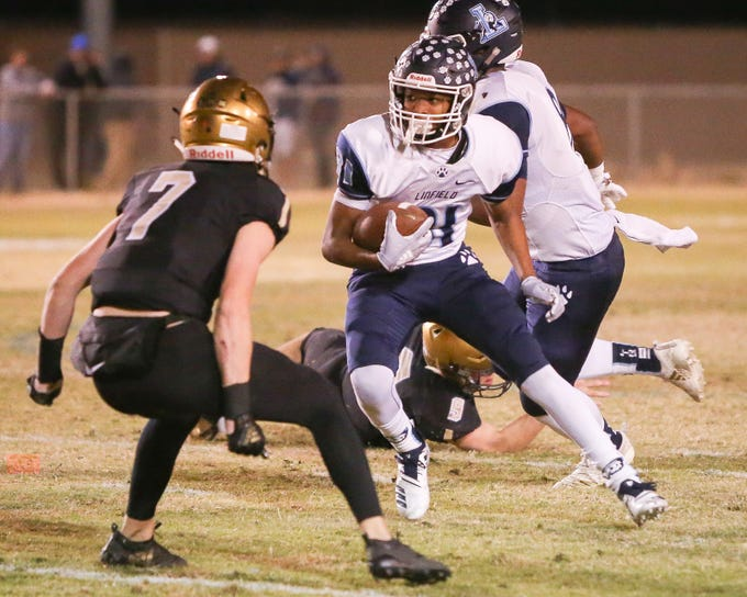 Jalani Jefferson jukes to the right. The Xavier Prep varsity football team lost Friday's neutral playoff game against Linfield Christian by a score of 57-13.