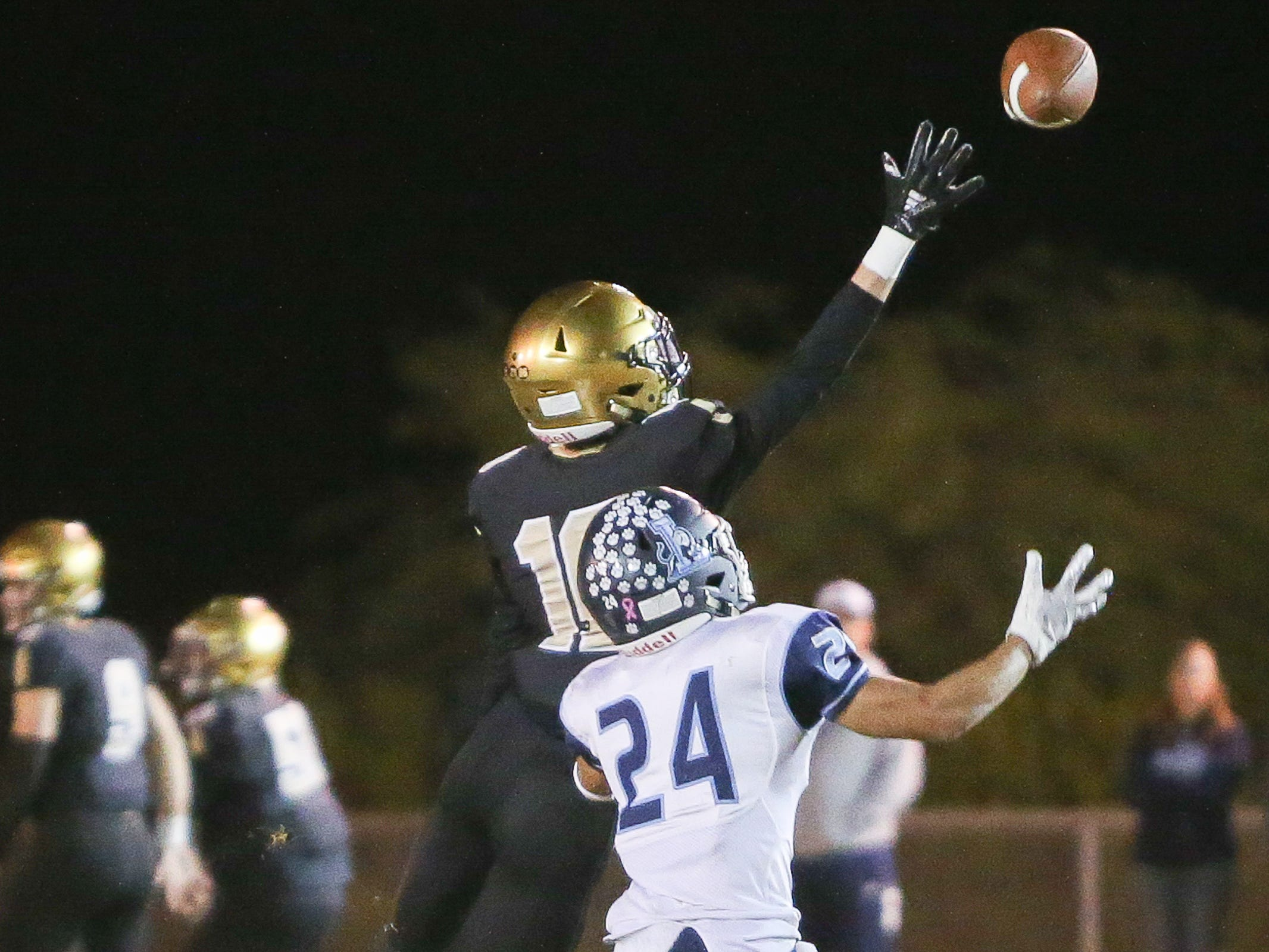 Jace Macconnell reaches for the ball.  The Xavier Prep varsity football team lost Friday's neutral playoff game against Linfield Christian by a score of 57-13.