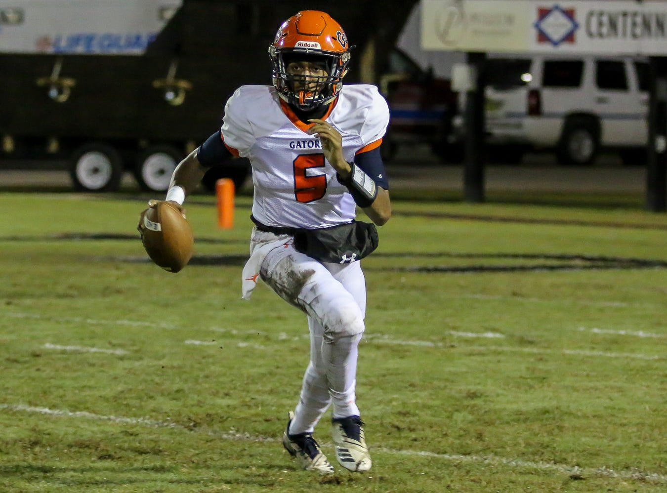 Escambia quarterback AV Smith (5) can't find an open receiver and runs toward the sideline against the Raiders in the Region 1-6A Semifinal game at Navarre High School on Friday, November 16, 2018.