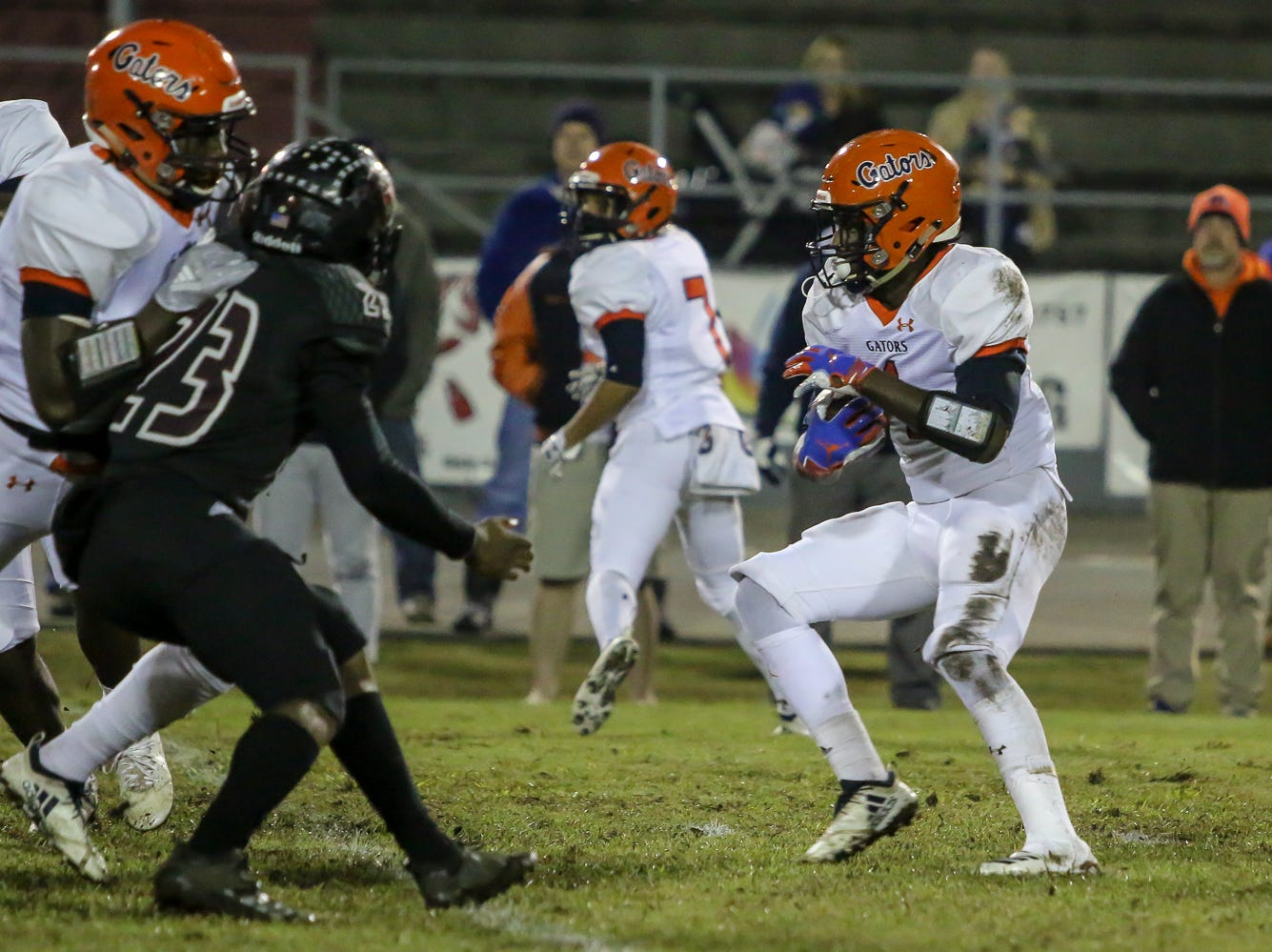 Escambia running back Frank Peasent (1) tries to find an opening to run through against Navarre in the Region 1-6A Semifinal game at Navarre High School on Friday, November 16, 2018.