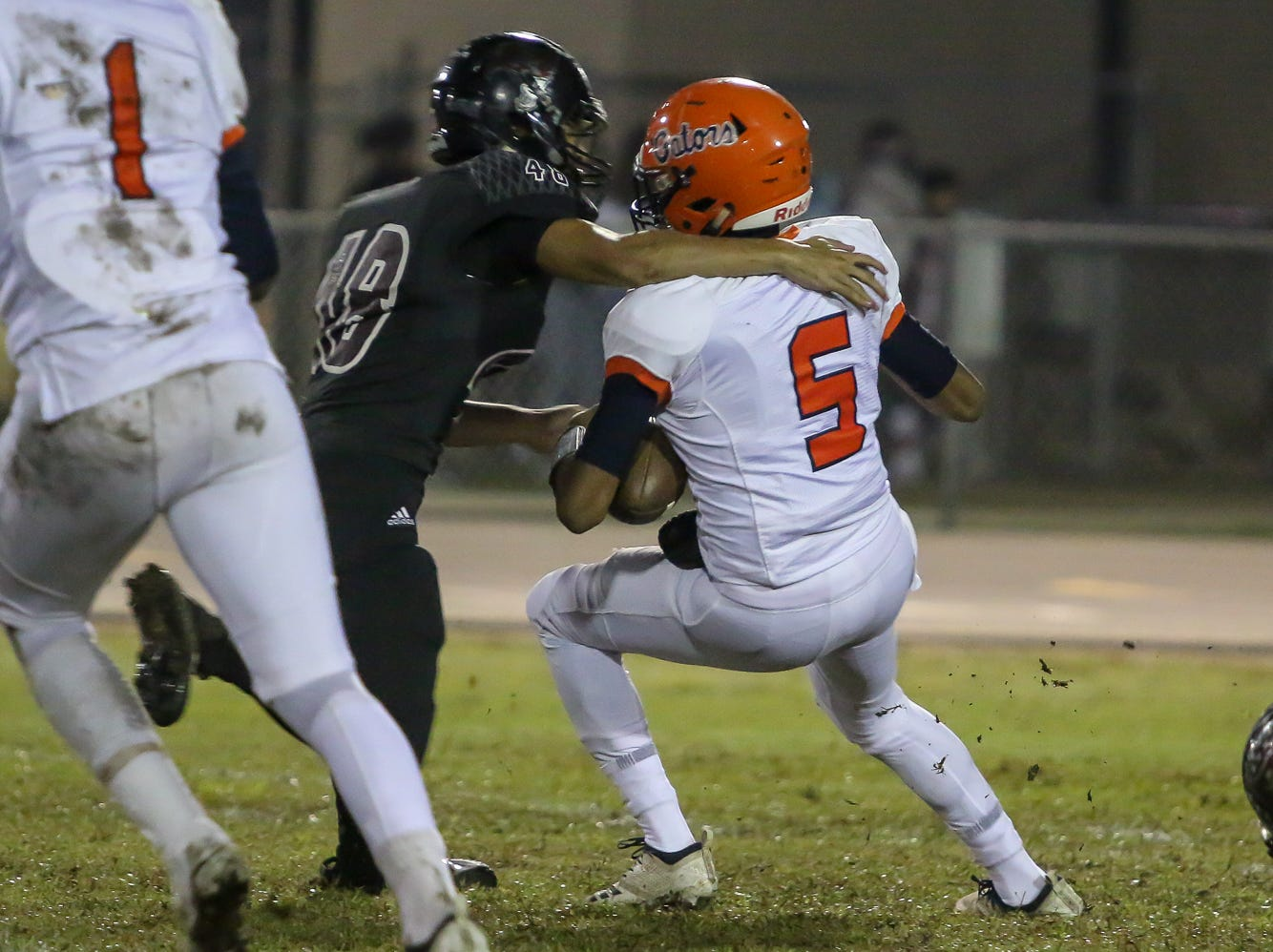 Navarre's Isaiah Heyward (48) sacks Escambia quarterback AV Smith (5) in the Region 1-6A Semifinal game at Navarre High School on Friday, November 16, 2018.