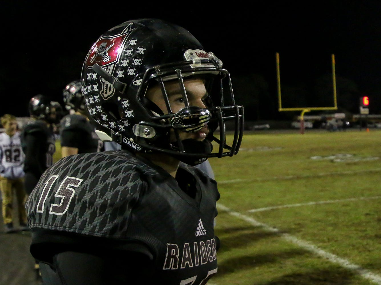 Navarre's Zach Simpson (15) watches a play against Escambia in the Region 1-6A Semifinal game at Navarre High School on Friday, November 16, 2018.