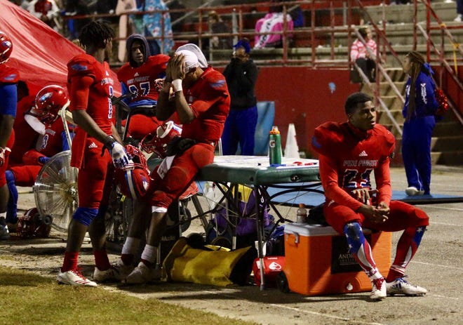 Pine Forest players sit on the sideline dejected toward the end of Friday's state playoff loss to Crestview.
