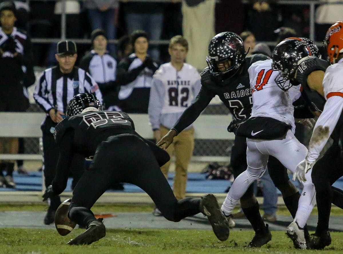 Navarre's Alex Gilchrist (95) jumps on the loose ball after it touched an Escambia player on a Raiders' kickoff in the Region 1-6A Semifinal game at Navarre High School on Friday, November 16, 2018.