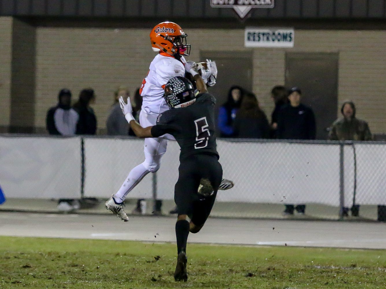 Navarre's Dante Wright (5) breaks up a pass that initially landed perfectly in the hands of Escambia's Deterius Gideon (6) in the Region 1-6A Semifinal game at Navarre High School on Friday, November 16, 2018.