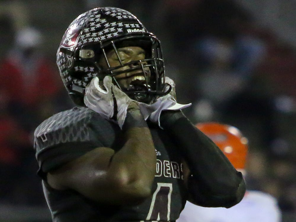 Navarre's Joshua Carter (4) celebrates after a play against Escambia in the Region 1-6A Semifinal game at Navarre High School on Friday, November 16, 2018.