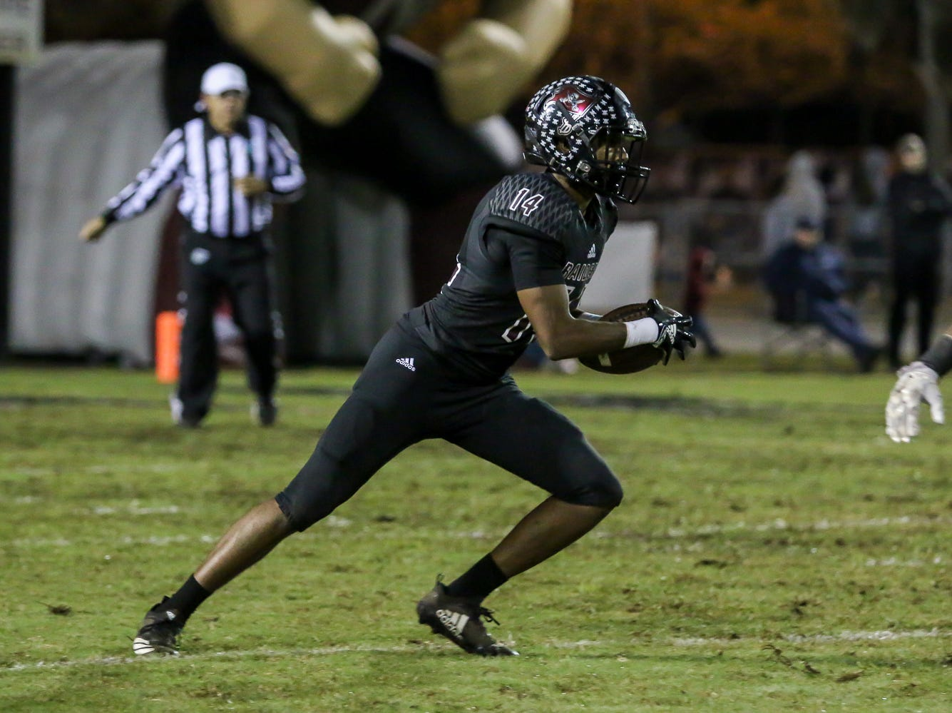 Navarre's Quinn Caballero (14) runs the ball back up the field against Escambia in the Region 1-6A Semifinal game at Navarre High School on Friday, November 16, 2018.