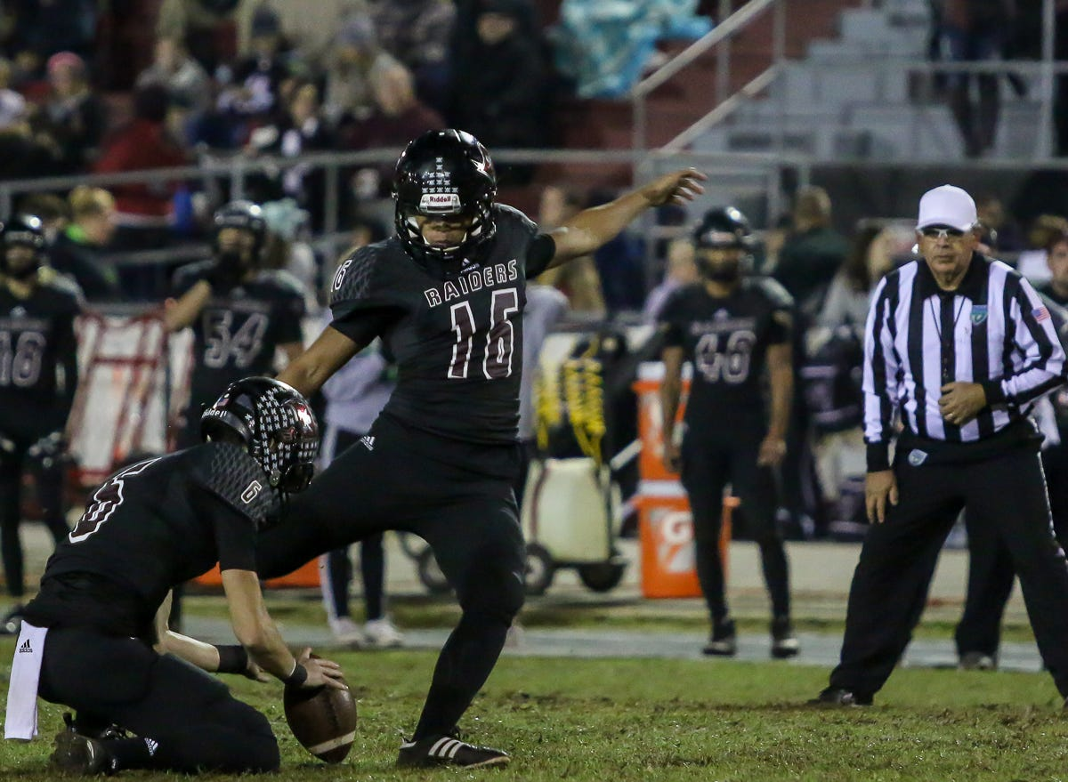 Navarre's Kevin Taich (16) kicks an extra point against Escambia in the Region 1-6A Semifinal game at Navarre High School on Friday, November 16, 2018.