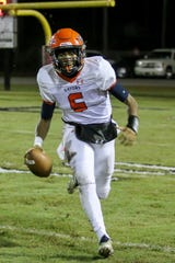 Escambia quarterback AV Smith (5) is one of the Pensacola-area's biggest sleepers in terms of football recruiting.