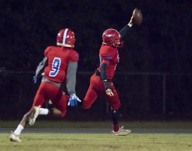 Taajhir Mccall (30) takes a Bulldogs fumble recovery in for a touchdown and a 13-7 lead after adding the extra point during the Crestview vs Pine Forest playoff football game at Pine Forest High School on Friday, November 16, 2018.