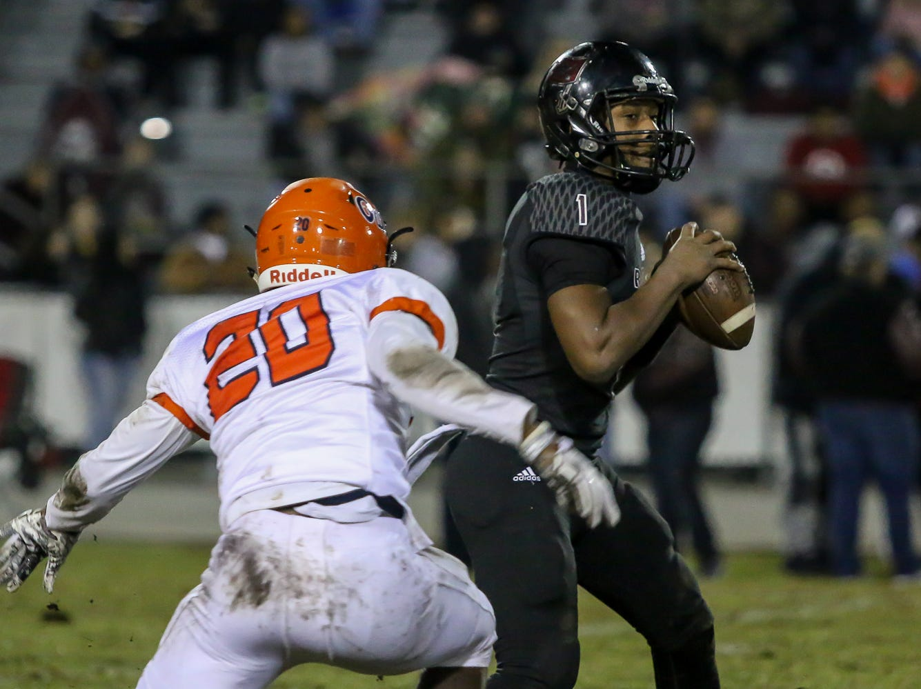 Navarre quarterback Marlon Courtney III (1) stays in the pocket and passes the ball before Escambia's Tyshan Edwards (20) can get to him in the Region 1-6A Semifinal game at Navarre High School on Friday, November 16, 2018.