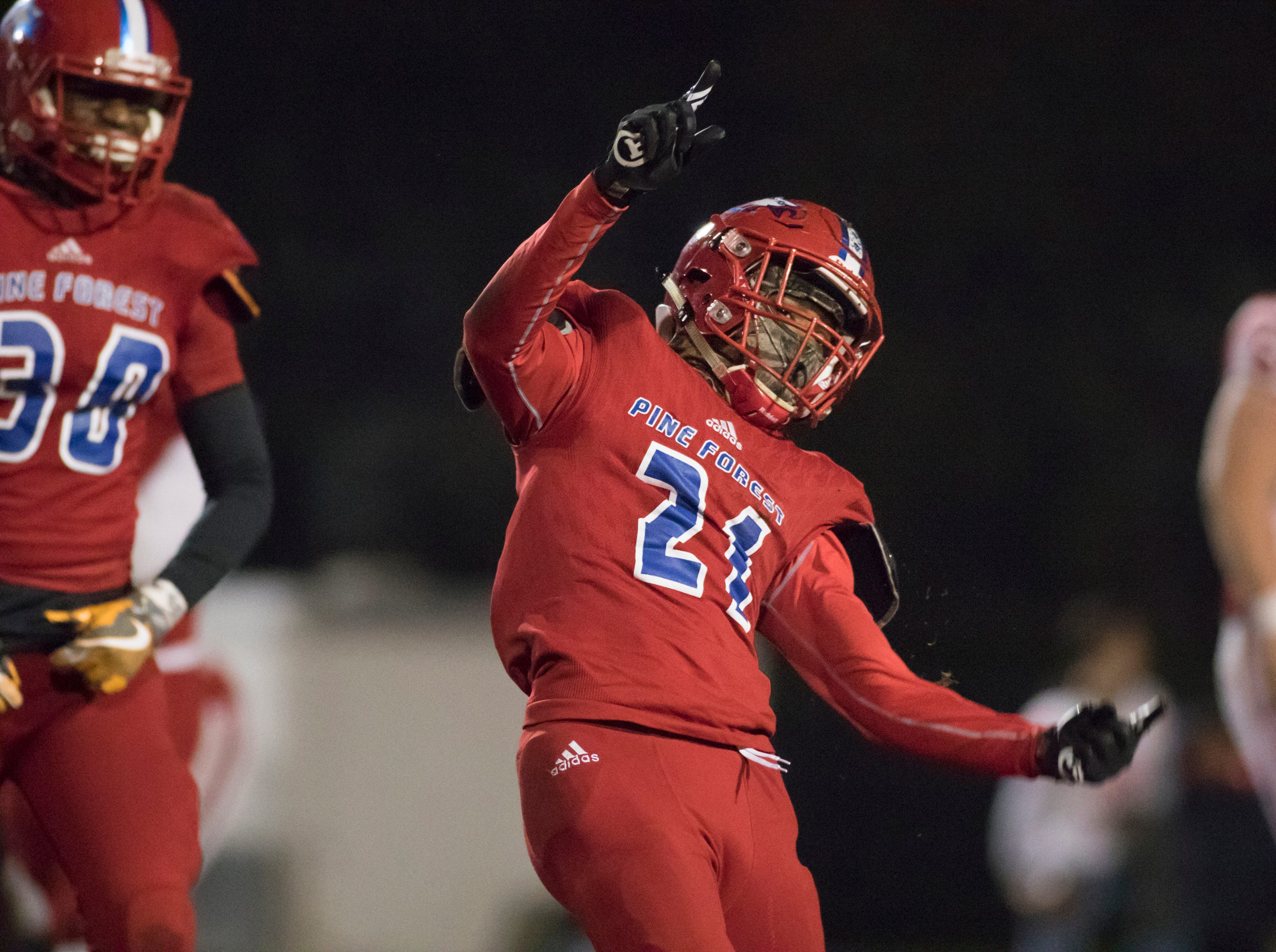 Devon Witherspoon (21) celebrates after making a sack during the Crestview vs Pine Forest playoff football game at Pine Forest High School on Friday, November 16, 2018.