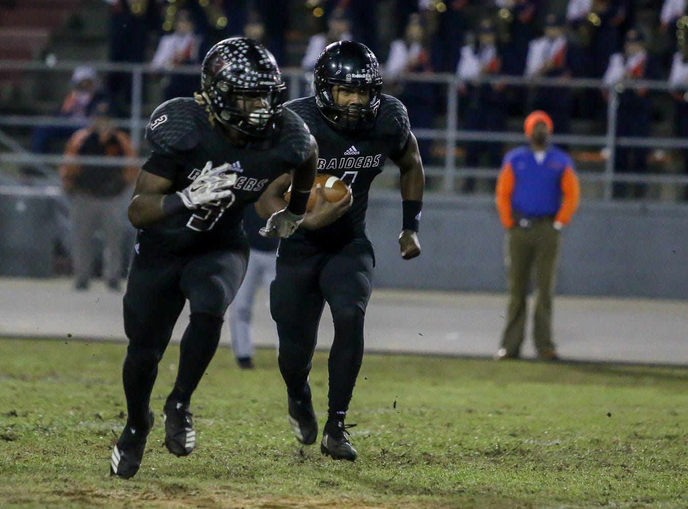 Navarre quarterback Marlon Courtney III (1) keeps the ball and follows his lead blocker, Christopher Williams (3), against Escambia in the Region 1-6A Semifinal game at Navarre High School on Friday, November 16, 2018.