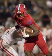 Vontarious Hill (4) carries the ball during the Crestview vs Pine Forest playoff football game at Pine Forest High School on Friday, November 16, 2018.