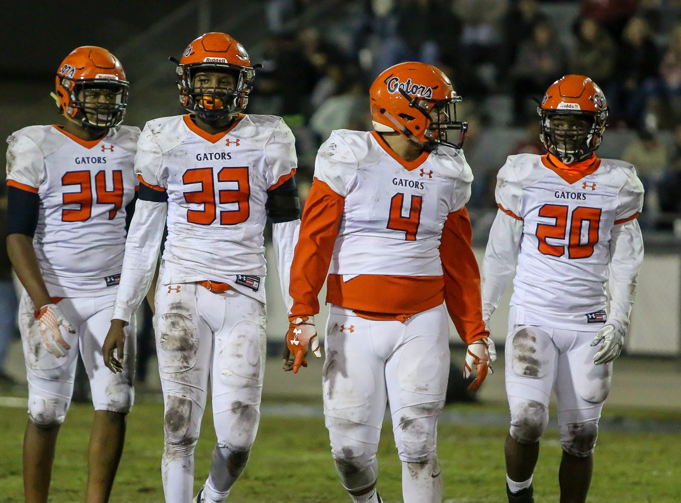 Escambia's Xavier Johnson (34), Joseph Minor (33), Noah Lord (4), and Tyshan Edwards (20) get ready for the next play against Navarre in the Region 1-6A Semifinal game at Navarre High School on Friday, November 16, 2018.