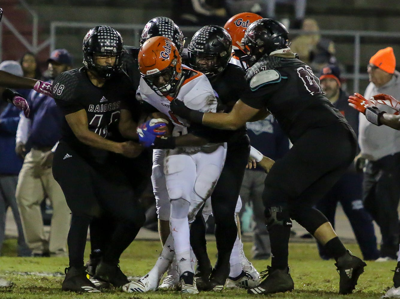 The Navarre defense wraps up Escambia's Frank Peasent (1) in the Region 1-6A Semifinal game at Navarre High School on Friday, November 16, 2018.