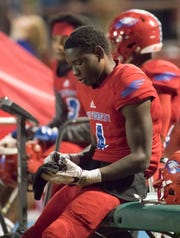 Vontarious Hill (4) sits on the sideline as the Bulldogs lead 49-19 late during the Crestview vs Pine Forest playoff football game at Pine Forest High School on Friday, November 16, 2018.