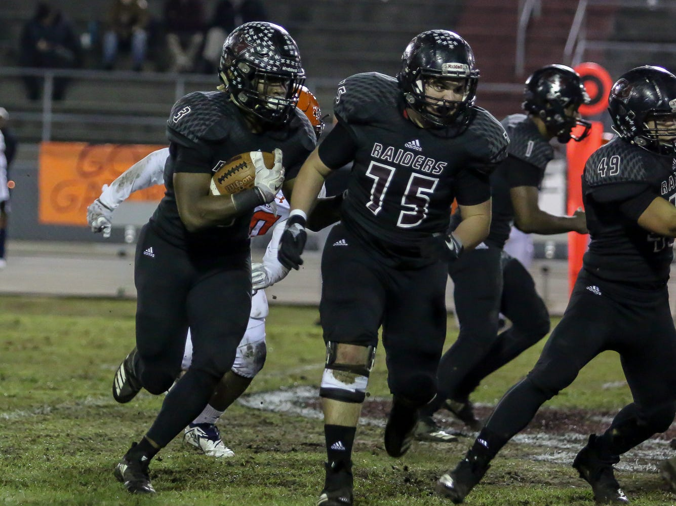 Navarre's Christopher Williams (3) runs the ball against Escambia in the Region 1-6A Semifinal game at Navarre High School on Friday, November 16, 2018.