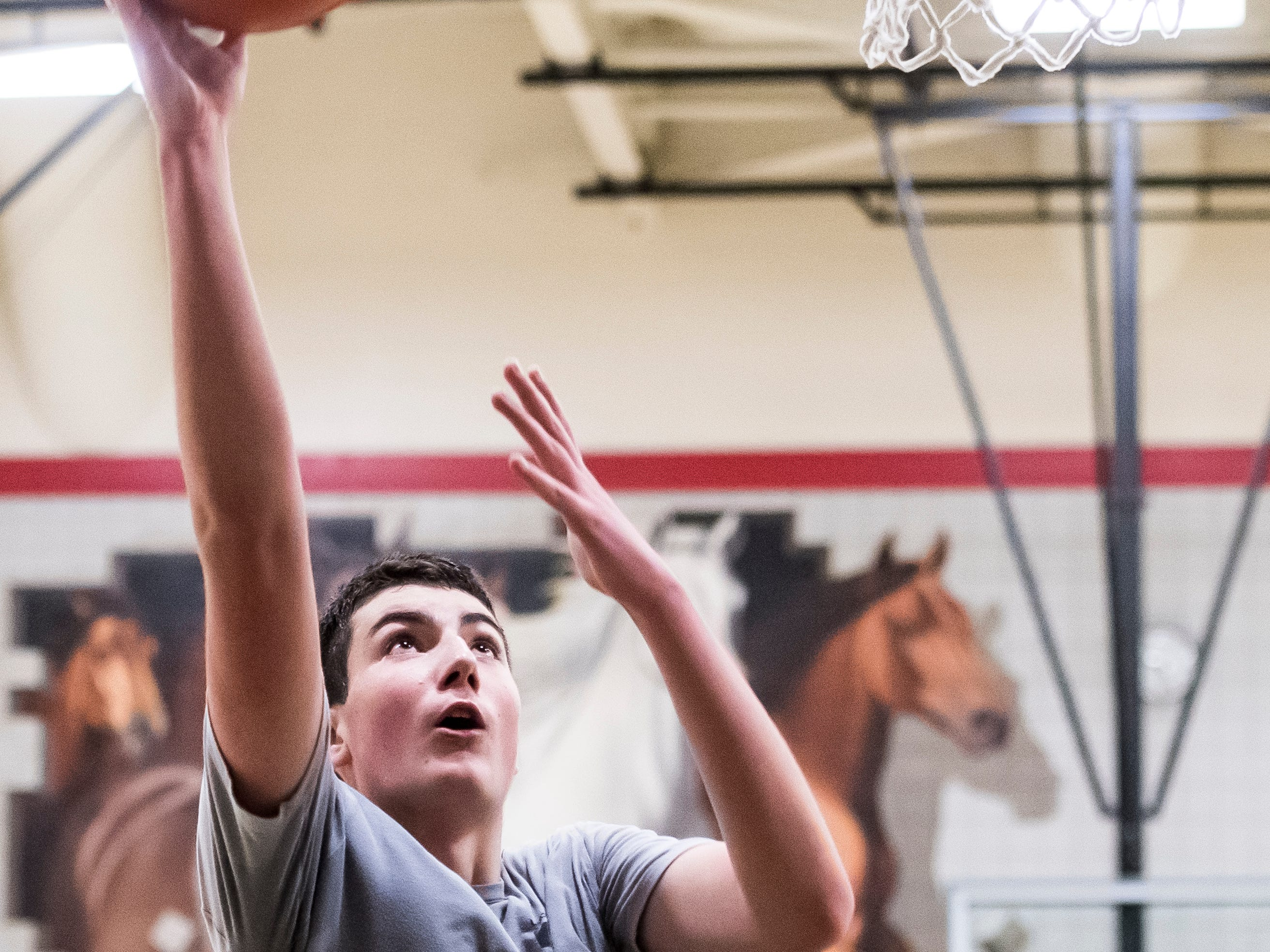 South Western's John Fenwick scores on a layup during the first official day of winter sports practice on Friday, November 16, 2018.