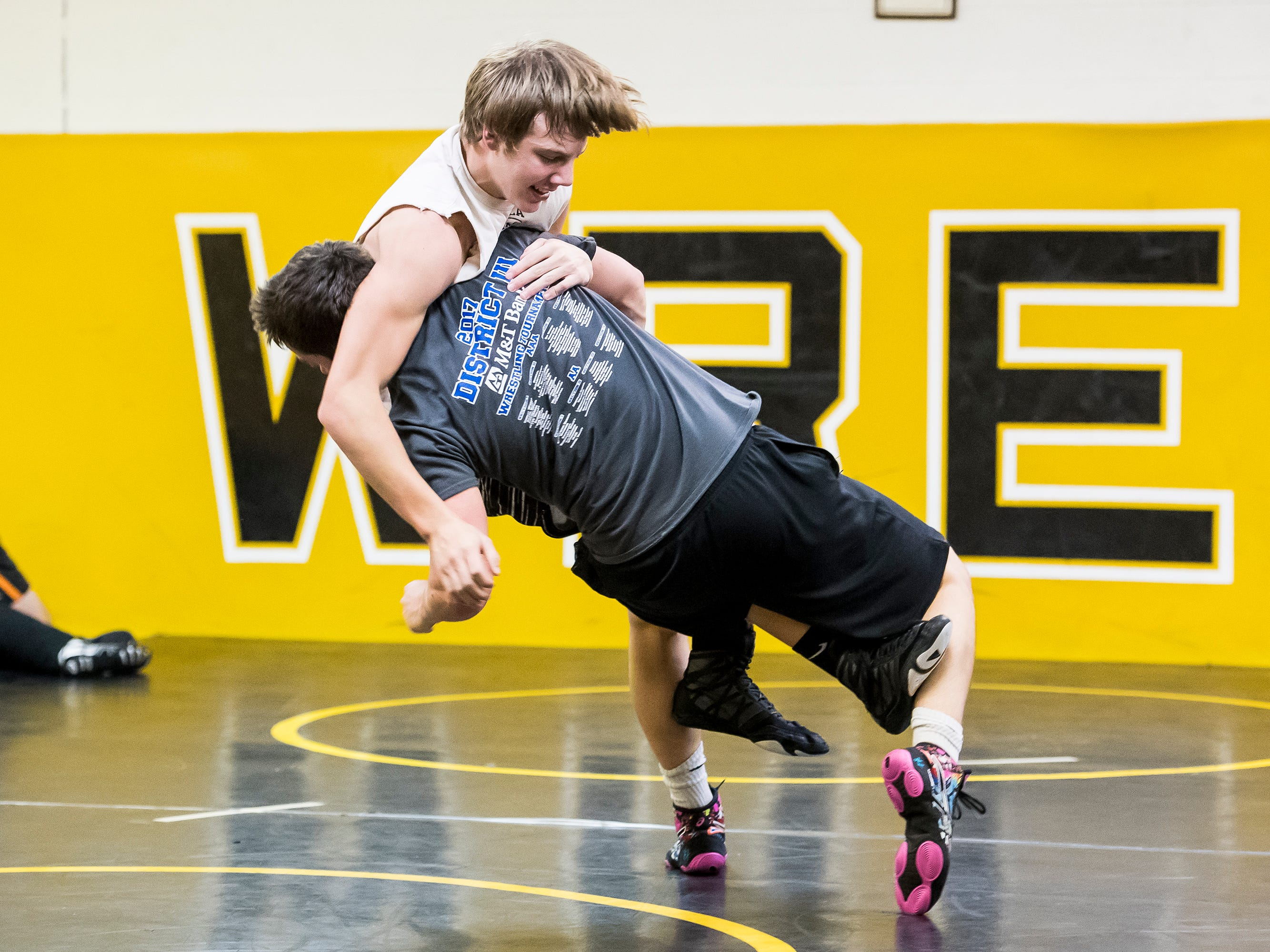 Delon Catholic's Robert Partenza takes down AJ Knobloch during a drill on the first official day of winter sports practice on Friday, November 16, 2018.